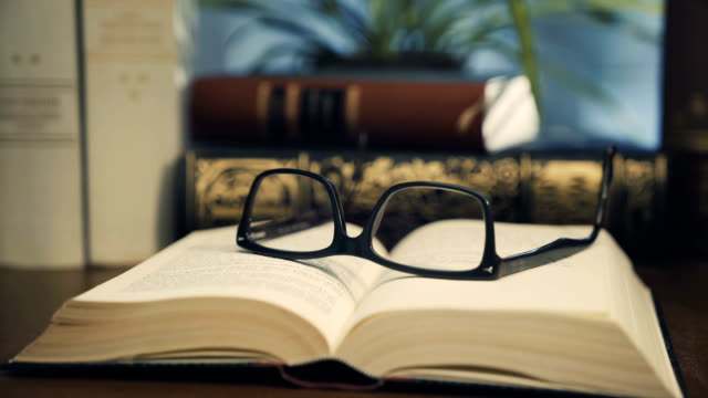 Old Books with glasses video