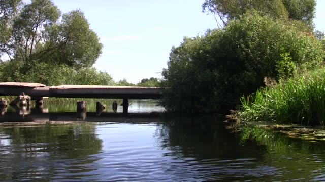 old bridge across the river with a quiet current video