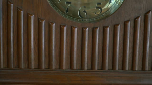 Old brown wooden clock