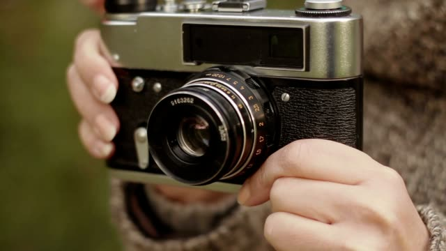 Old camera in the women's hands Old camera in the women's hands camera flash stock videos & royalty-free footage