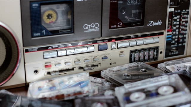 Old cassette tape recorder with cassettes. video
