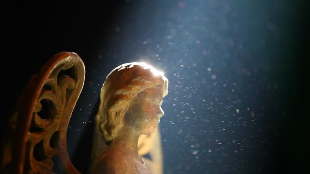 old ceramic angel dark background - angelo video stock e b–roll