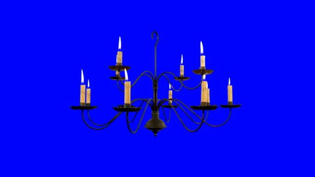 mavi ekran arka planda yanan mumlar ile eski avize - avize aydınlatma ürünleri stok videoları ve detay görüntü çekimi