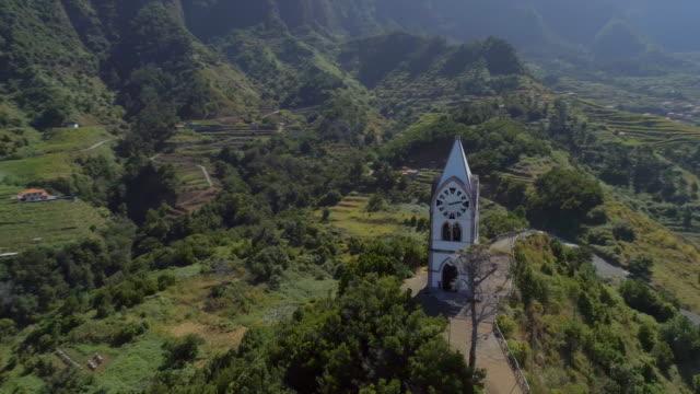 vídeos de stock e filmes b-roll de old chapel on a hill in madeira aerial view - funchal madeira