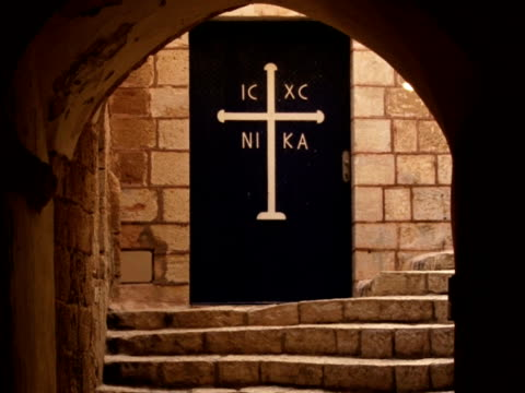Old church door with cross travelling video