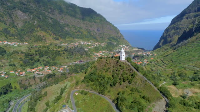 Old Clock Tower on a Hill in Madeira Madeira is a small Portuguese island, situated North of the Canary Isles in the Atlantic Ocean. The island boasts incredible scenery due to the volcanic landscape which creates vast and steep mountains across the 20 mile island. funchal stock videos & royalty-free footage