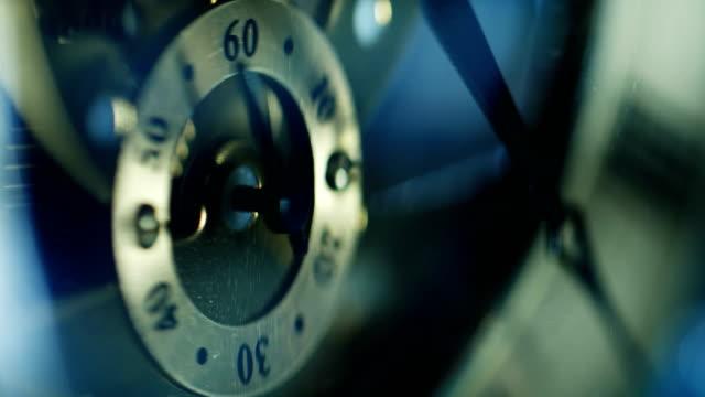 Old clock's mechanism: mechanism,hands,wheel- macro video
