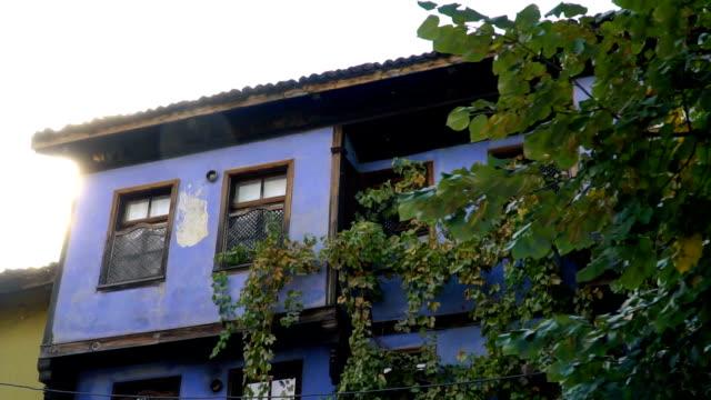 vídeos de stock e filmes b-roll de old colored wooden houses at bursa, turkey - ivy building