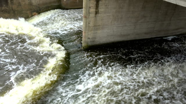 Old concrete river  lake dam construction and water splash video