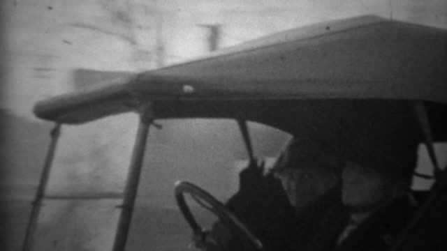 1936: Old couple driving classic custom Ford model A pickup truck. video