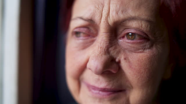 Old depressed woman crying