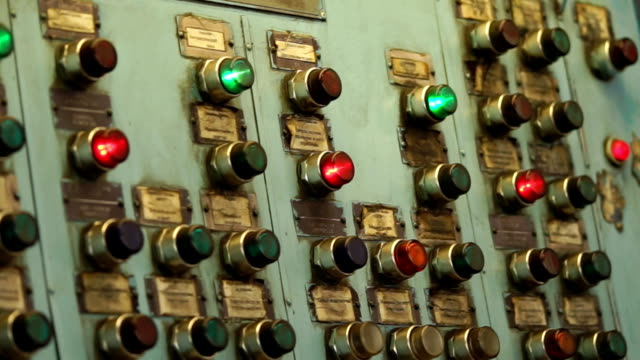 Old dirty control panel with green and red buttons in plant. video