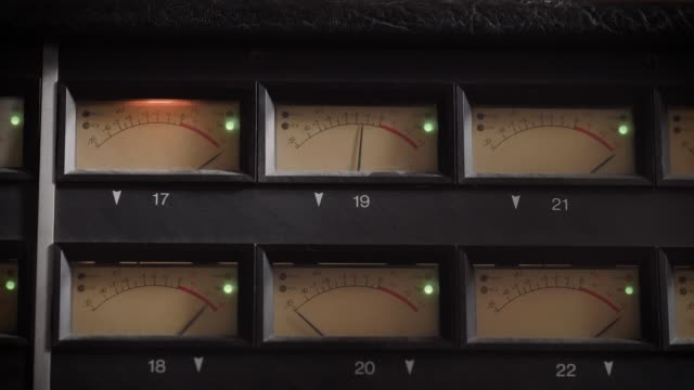 old displays of professional analog vu metres in a recording studio, measuring and showing decibels - radio video stock e b–roll