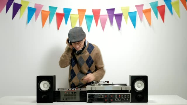Old DJ playing music and gesturing happiness video