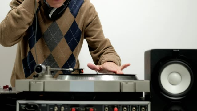 Old DJ scratching on a turntable video
