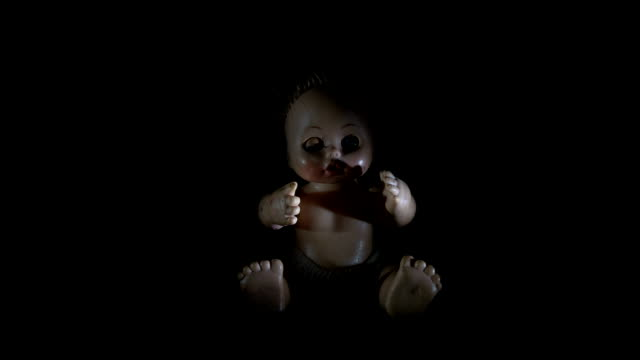 old doll appears from the darkness with the exposed forward hands,very creepy old doll appears from the darkness with the exposed forward hands,very creepy FullHD doll stock videos & royalty-free footage