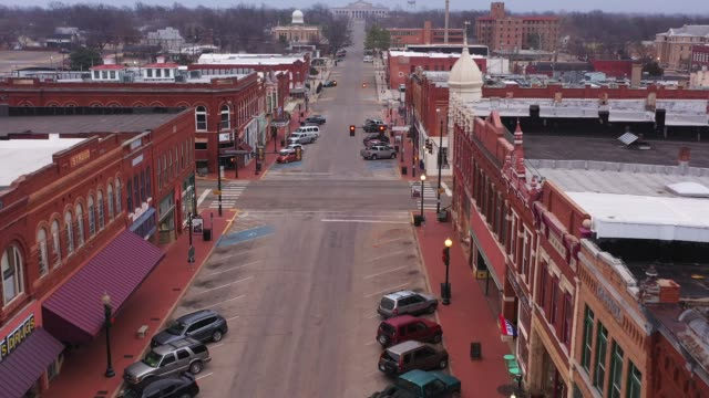 old downtown retail businesses, guthrie, oklahoma, usa - antique shop stock-videos und b-roll-filmmaterial