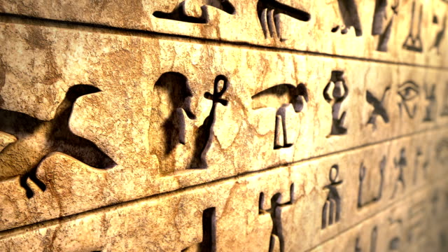 Old egyptian hieroglyphs on the stone wall video