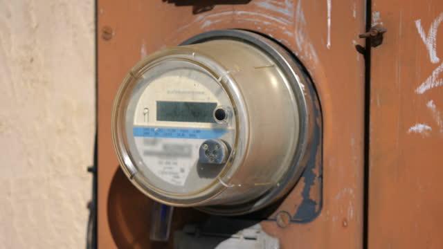 Old electric energy meter in 4k