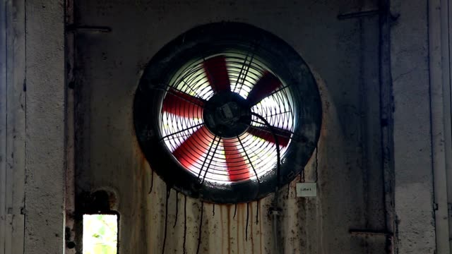 Old fan in the wall of abandoned factory video