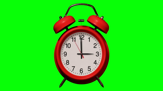 Old fashioned Red alarm clock rings at 3 O'Clock on Chroma Key Background