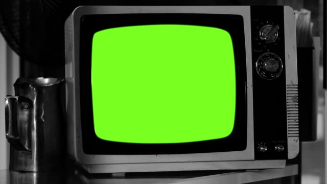 Old Fashioned Tv Turns On With Green Screen. Black And White Tone.