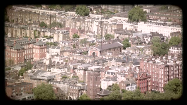old film aerial view of housing developments in london, uk. 4k - blickwinkel aufnahme stock-videos und b-roll-filmmaterial