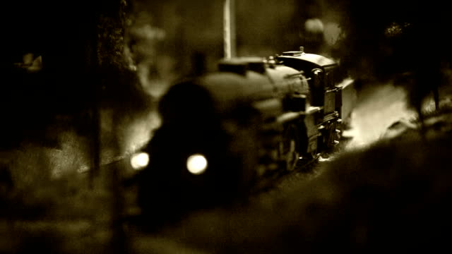 Old film effect footage model railway with old-fashioned locomotive on the route video
