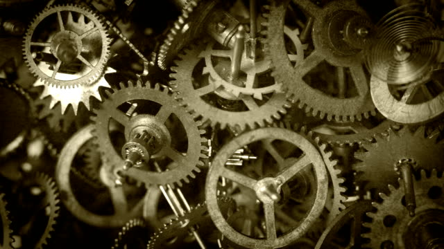 Old film footage: different kinds of gears from clock mechanisms video