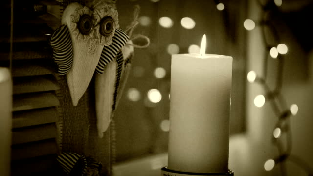 Old film footage of a christmas candle sitting on the windowsill video