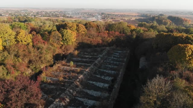 Old Fortress in the Forest, Tarakaniv Fortress Flight Over the Roof of the Old Fortress, Tarakaniv Fortress, Forest Around an Abandoned Fortress of Second World War eastern europe stock videos & royalty-free footage