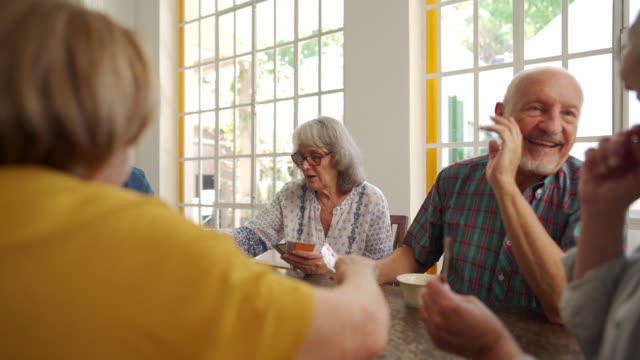 Old friends people playing cards in retirement home video