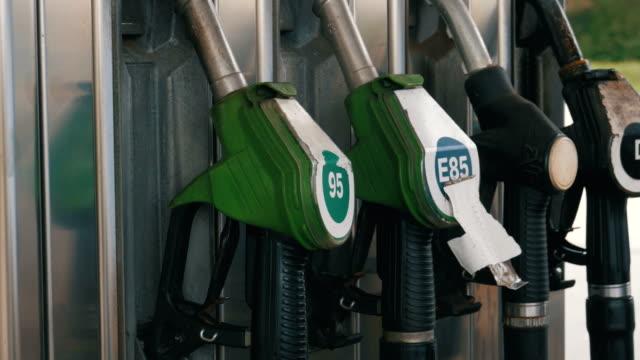 Old Gasoline or petrol station gas fuel pump nozzle. Filling station. Petrol station