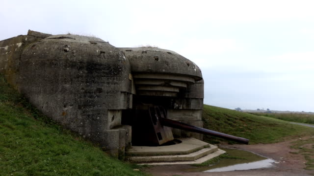 Old German bunker in Omaha Beach Omaha beach is one of the  landing areas of World War 2 normandy stock videos & royalty-free footage