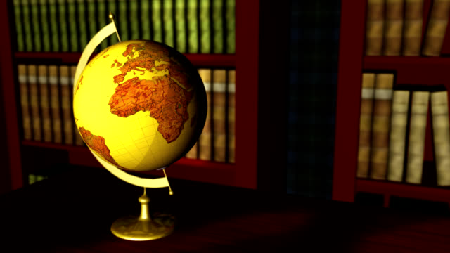 Old globe in a classic library interior video