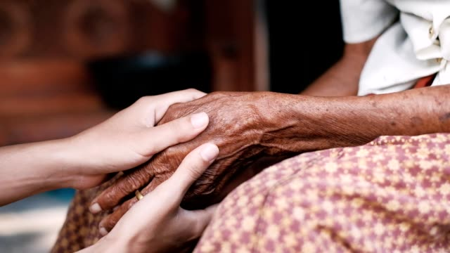 Old hand in young hands for Holding, Helping, Giving Support