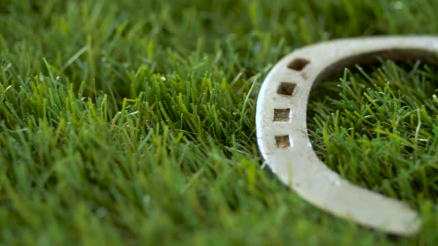 old horseshoe on artificial grass - horseshoe stock videos & royalty-free footage