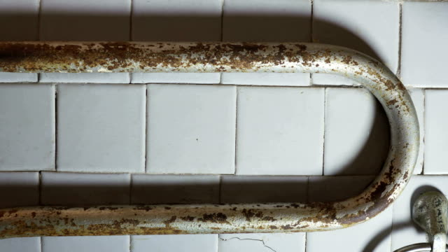 Old house interior rusty pipes in the bathroom video
