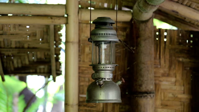 Old lamp hanging under the roof. video