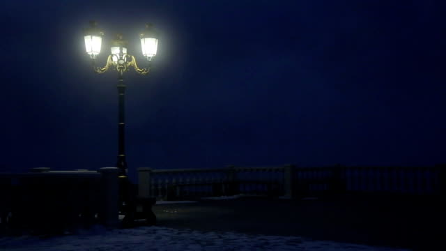 old lantern at night in foggy park video