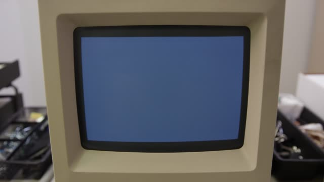 Old Macintosh Classic Computer screen slowly turns on