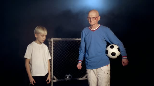 Old Man And Young Soccer Player video