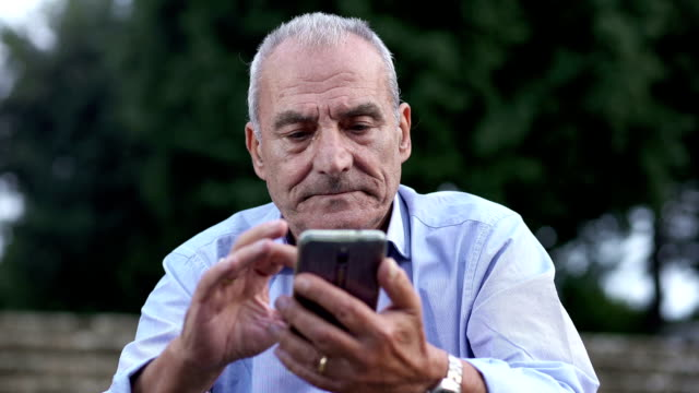 old man chatting with cell phone video