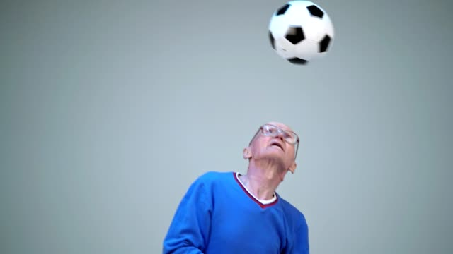 Old Man Is Hitting Ball With His Head And Juggling It video