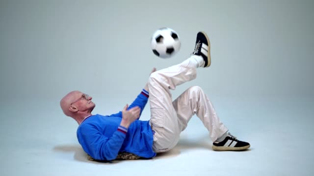 Old Man Is Lying On Back And Juggling with Ball video