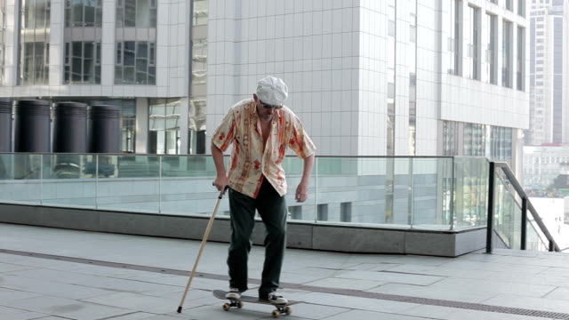 old man on a skateboard. - skateboarding stock videos and b-roll footage
