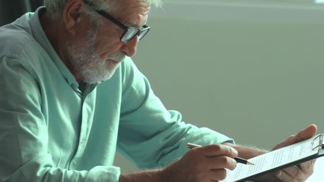 Old man reading  form