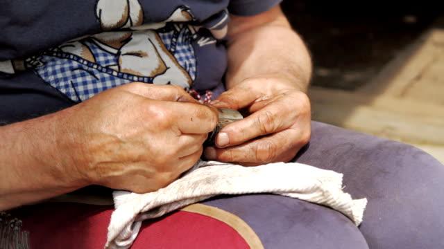 Old man repairs a damaged piston. video