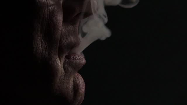 Old man smoking video