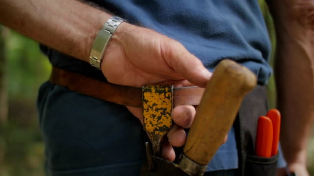 Old man's hands holding tool belt video